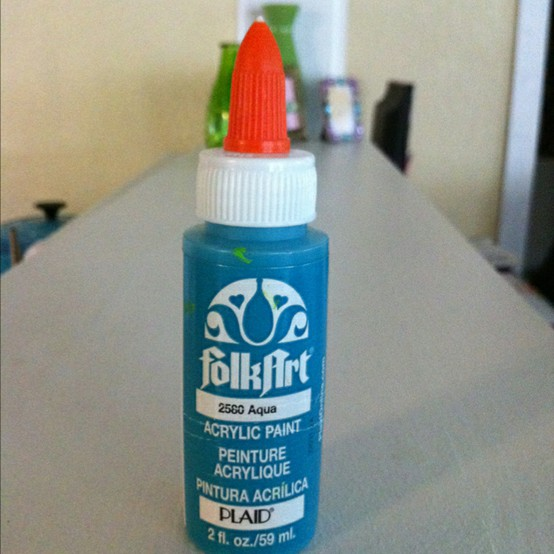 Put a glue top on acrylic paint bottle and you can write with it.