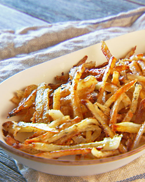 The secret to awesome oven fries is presoaking them in salted water, which makes