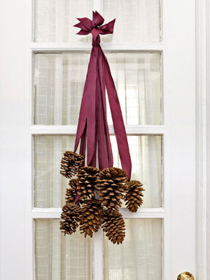 Not all front-door decor must be round. This fall, try this fetching pinecone ha