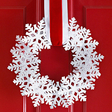 Use a pack of dollar store snowflakes for this easy winter wreath
