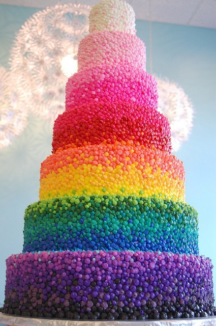 Incredible rainbow wedding cake, crafted with thousands of tiny frosting dots. C