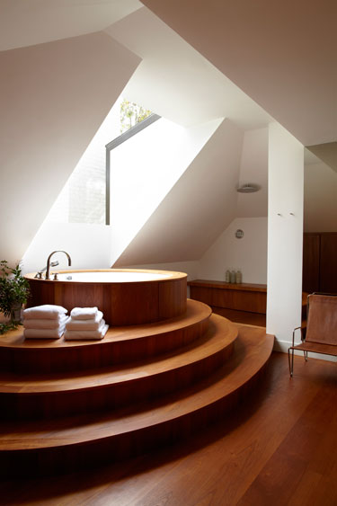 A stepped teak tub deck is the focal point of the master - The bath point ...