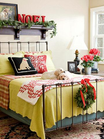 Red and green bedding paired with fresh greens create festive Christmas decor. C