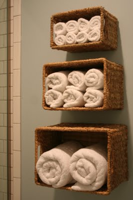Baskets. A way to keep bath linens close to the shower, and not taking up closet
