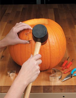Carve a pumpkin using cookie cutters! I guess this explains all those PERFECT lo