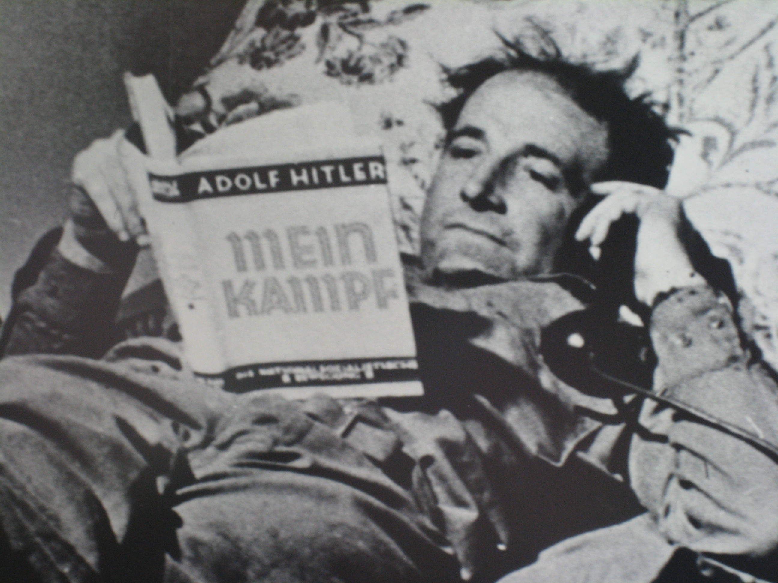 Oklahoma soldier from the 45th, Sgt. Arthur E. Peters, reclining on Hitler&#8217