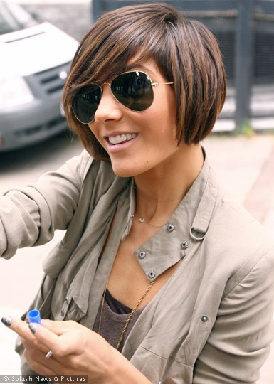 The next logical step of an asymmetrical short hair cut in growing it out is a b