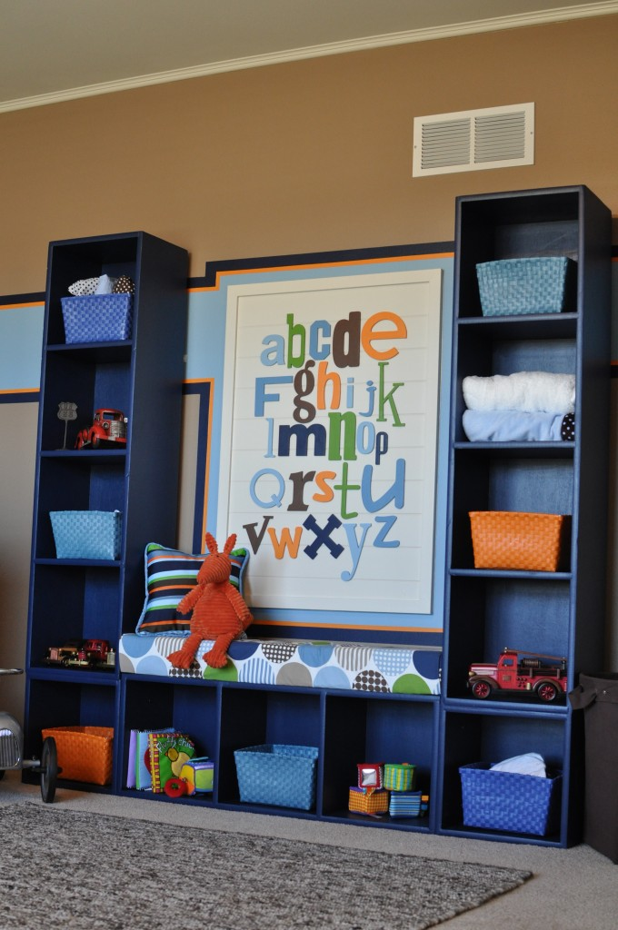 3 bookcases screwed together. Love the little bench it creates!