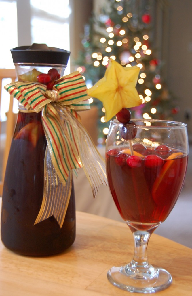 Christmas Sangria 2 bottles Merlot 1 bottle ginger ale 1 cup sugar 1 tsp ground