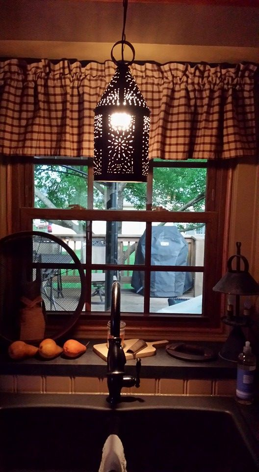 Primitive lighting, faucet, curtains