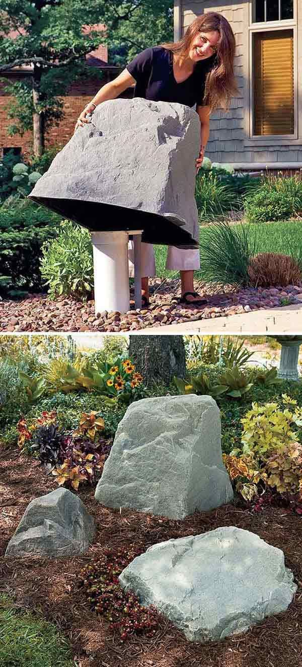 #10. Faux giant stone to hide the ugly stuff in the garden.