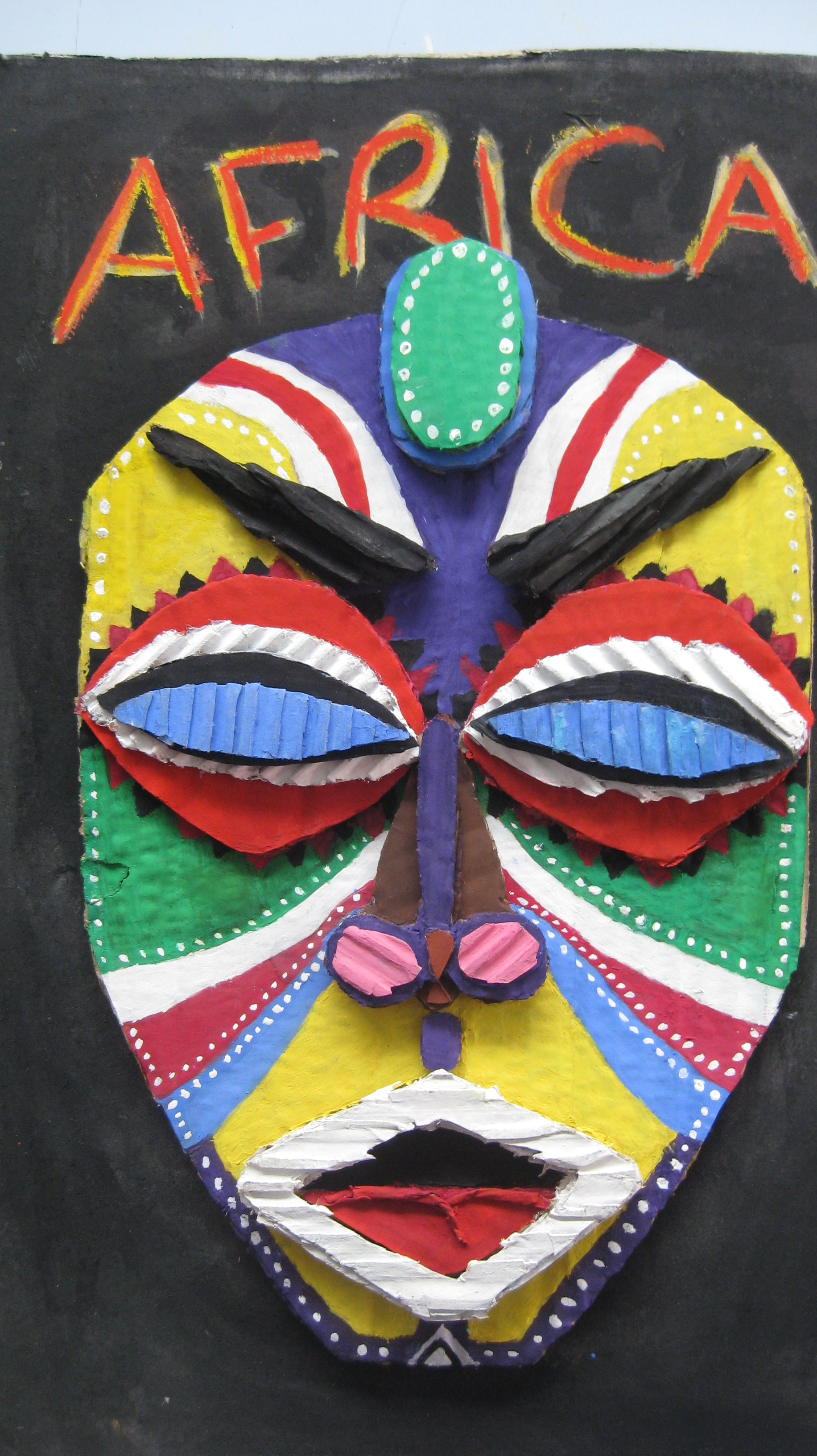 Lovely cardboard mask made from layering of cardboards for theme Africa