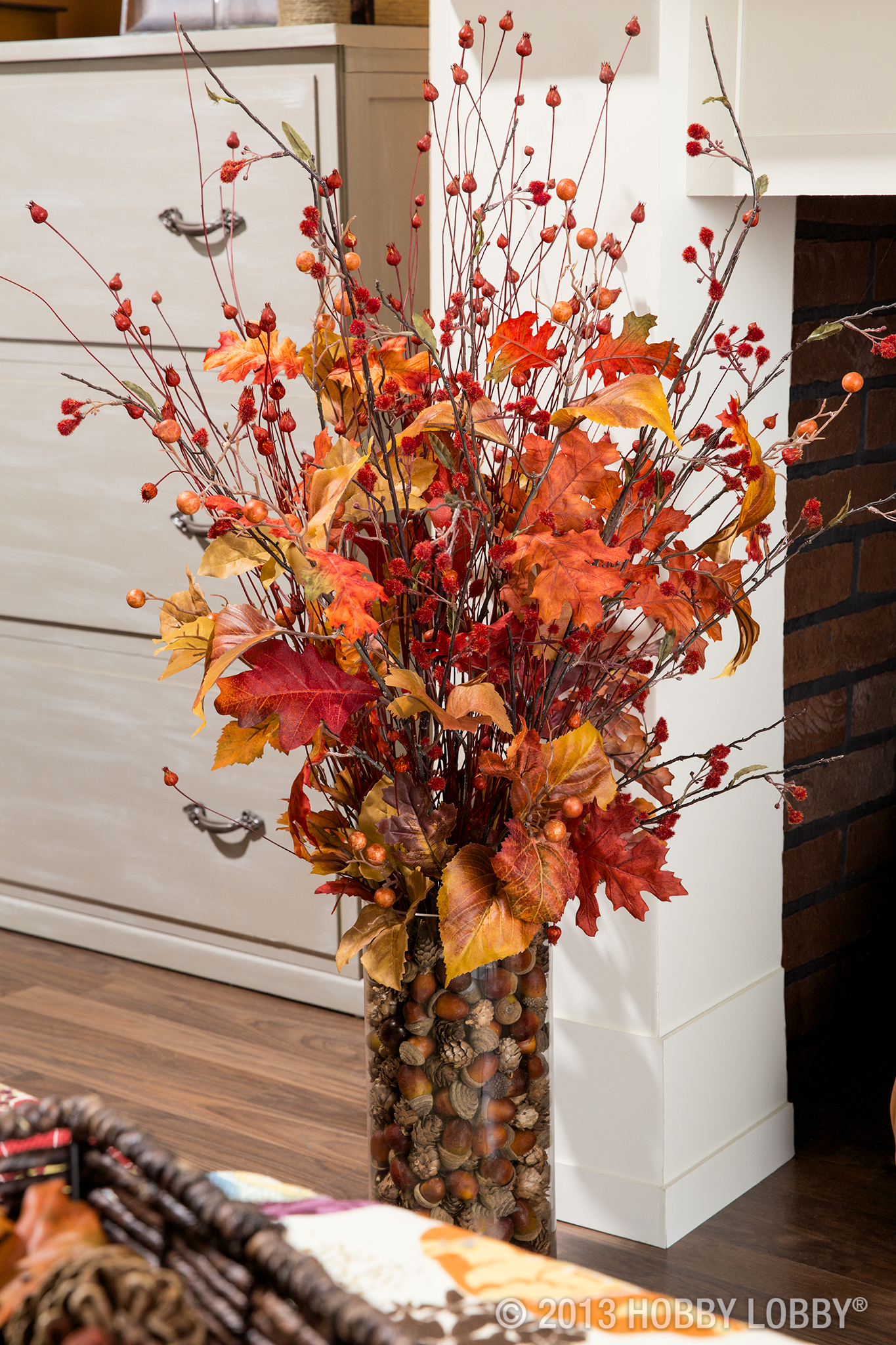 Use faux-floral stems for a flower arrangement that will last all the way through the chilly days of Fall and Winter and straight