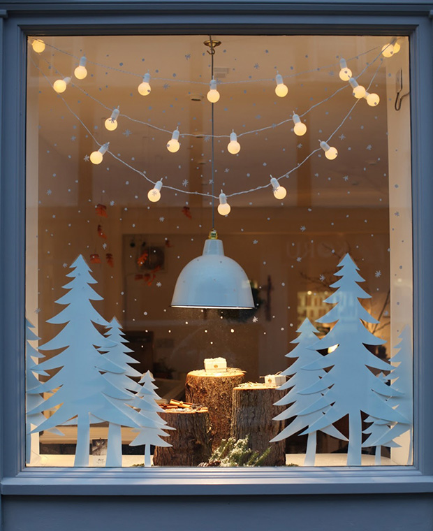 Design editor Kai Ethier shares ideas for small space holiday decor, like Christmas trees, window displays, candles and more.
